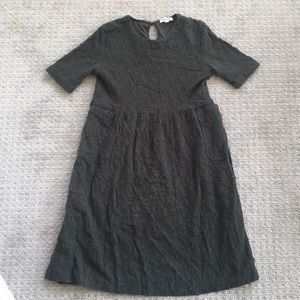 Knee length olive green dress from Roolee